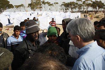 global refugee crisis, UK MInister talks to refugees in Tunisia