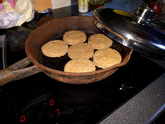 biscuits in the pan with the lid about to go on.