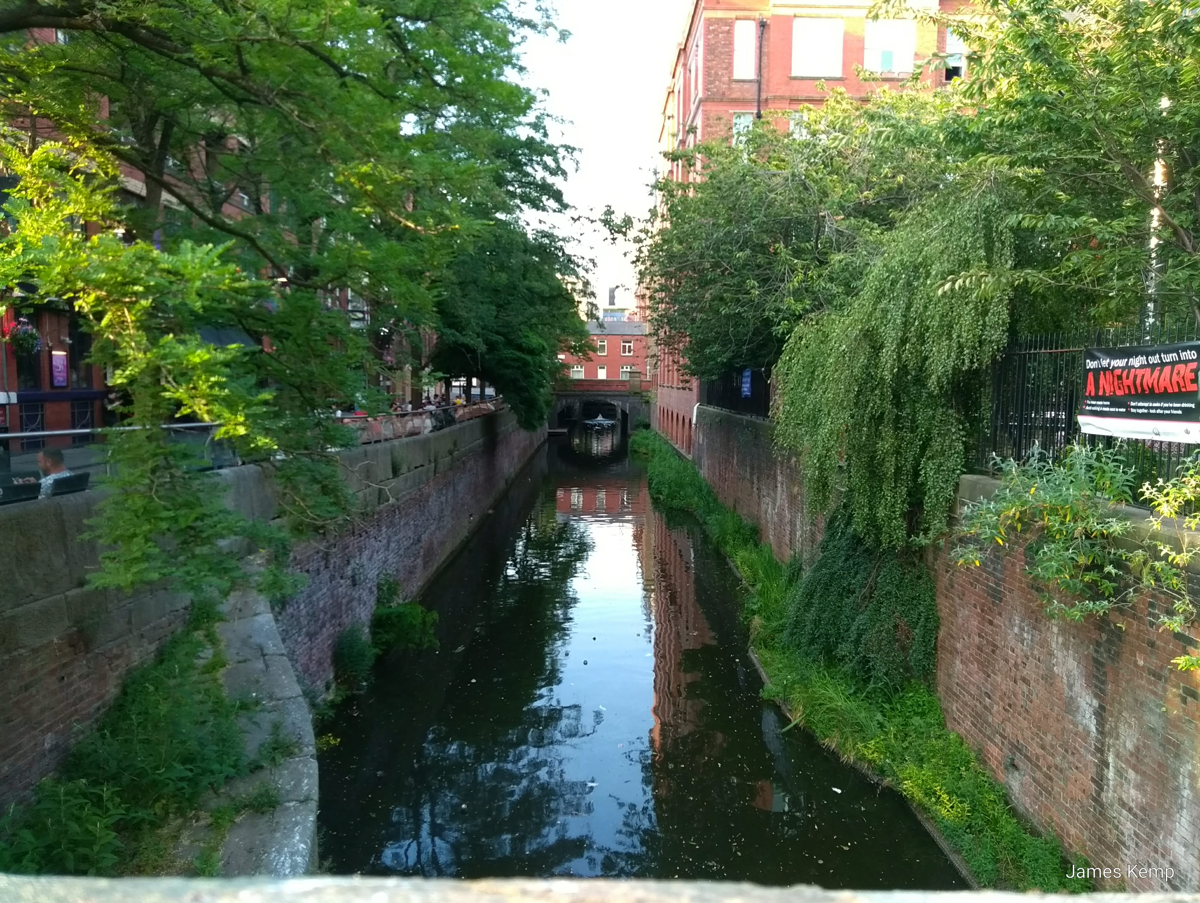A Manchester canal, running alongside Canal Street (right) and Sackville Park (left). (Photo: James Kemp)